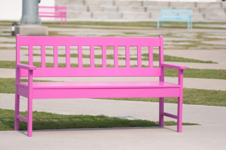 pink street chair in the park photo