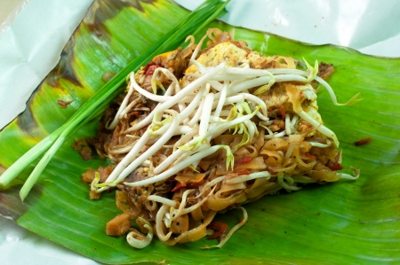 Thai noodle fried on green banana leaf photo