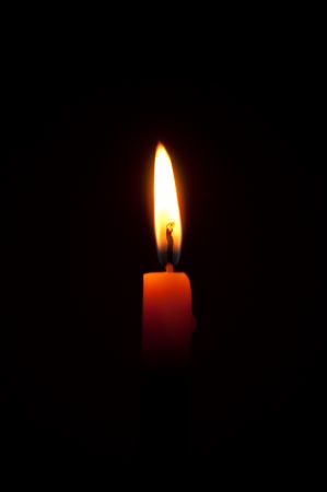 candle flame on black background photo