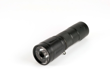 black flashlight on white background