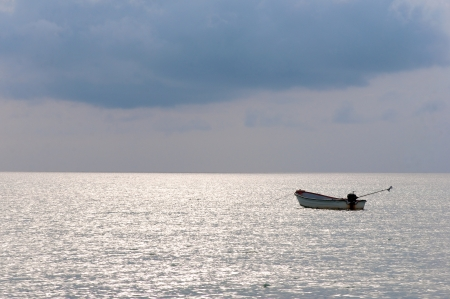stagnate: small fishing boat in the sea