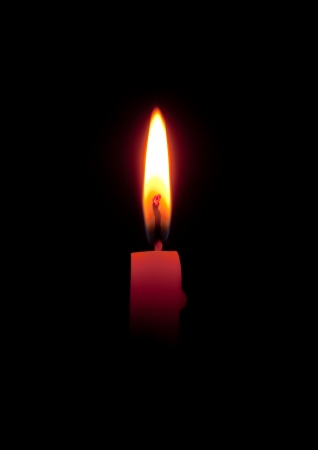 burning love: candle flame on black background