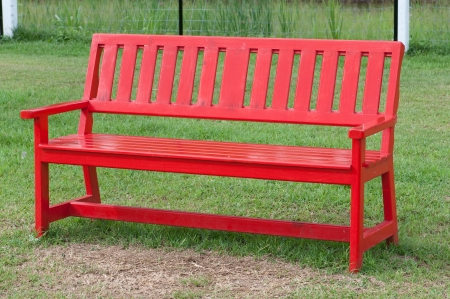 Lonely red wooden bench in the park  photo