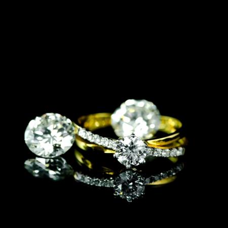 wedding diamond ring on black background photo