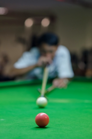poolball: a man playing snooker game