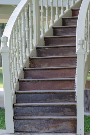 old teak wood stairs in the old house photo