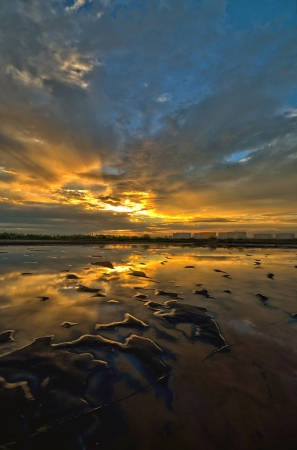 sunset at the salt farm in Petchaburi in Thailand photo