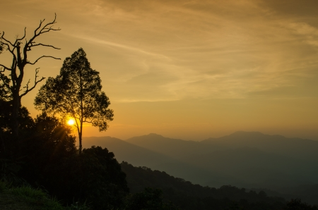 sunset at PanoenThung view point in Kaeng Krachan national park,Thailand photo