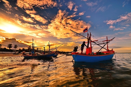 small fisherman boats in the sea near Hua Hin fisherman port,Thailand