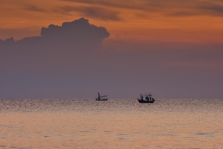 small filhing boats in the sea at Hua Hin Thailand in the morning photo