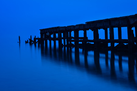 old Hua HIn fishing pier in twilight photo