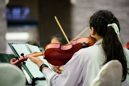 bowing: young woman violinist