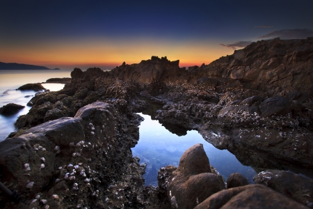 Tide pools at sunrise in kalim beach