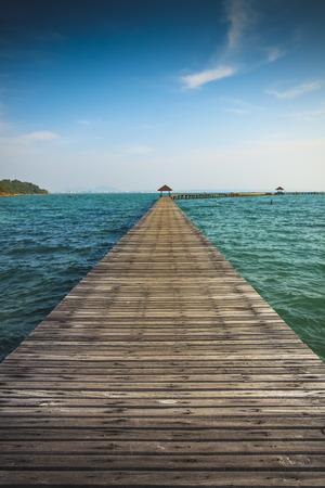 Wooden Bridge walk way to sea Stock Photo