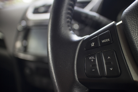 Sound audio and  music function control button on the left hand side of car steering wheel Stock Photo