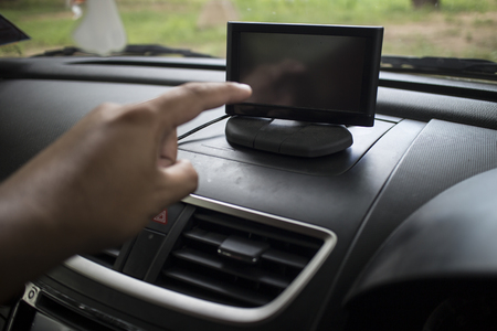 Finger push on navigation device, close-up and soft-focus Stock Photo