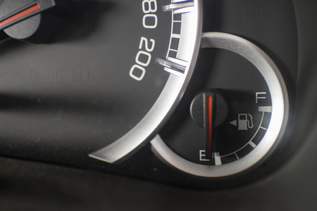 A fuel level their display stands on empty. Detail from the car cockpit, a symbol of the innovation of auto industry.