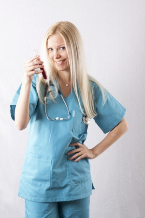 Pretty young female surgeon posing in uniform photo