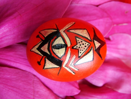 Beautiful painted easter egg on a colorful background photo