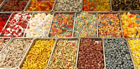 Many colorful Halloween sweets and candy filling background photo