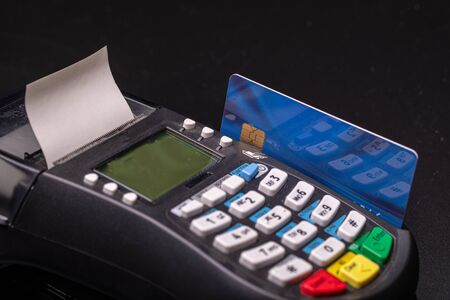 POS terminal, Payment Machine with credit card on black background. Contactless payment with NFC technology- Account on card (mine) closed over years ago!!!
