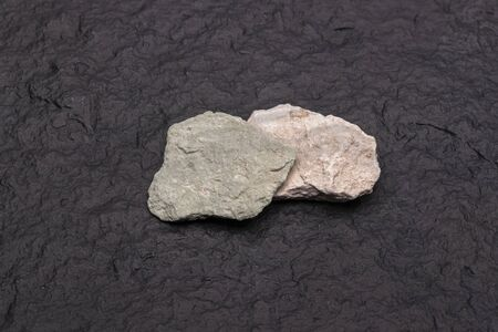 Close up stone of Zeolite mesolite raw stones on black  background.