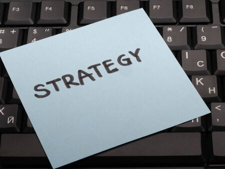 Writing note showing Strategy. Business photo showcasing proposed strategy or course of actions for certain time