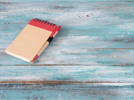 Notepad on wooden background.Concept photo Reklamní fotografie