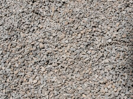 Abstract grey and beige gravel stone background crushed gray stones and granite pieces texture large detailed horizontal textured rough construction rock Stock Photo