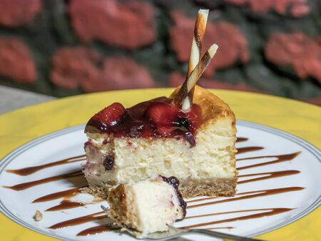 Cheesecake with  jam of guava on plate on table