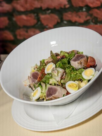 Salad  with eggs, tuna, anchovy, lettuce and olives