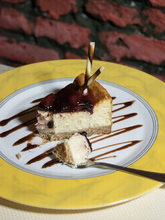 Cheesecake. Slice of Plain New York Cheesecake on white plate.