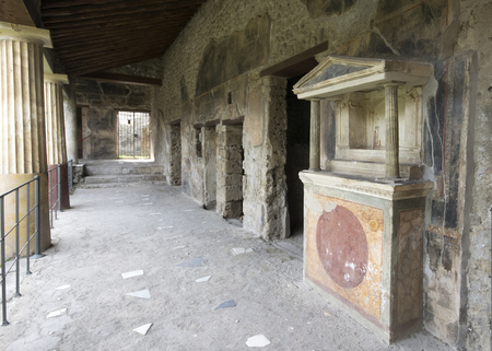 Entrance of a house ruin with painted walls at Pompei, Naples / Italy