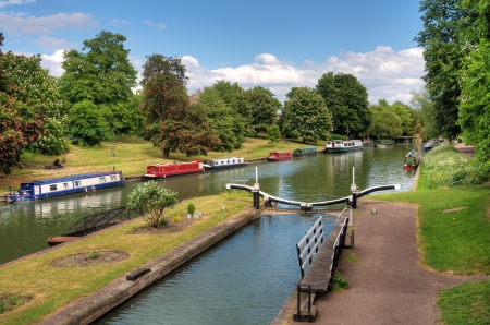 Canal boats on river Stock Photo