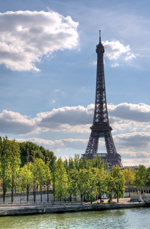 Scenic view of Eiffel tower with Seine river in foreground, Paris, France