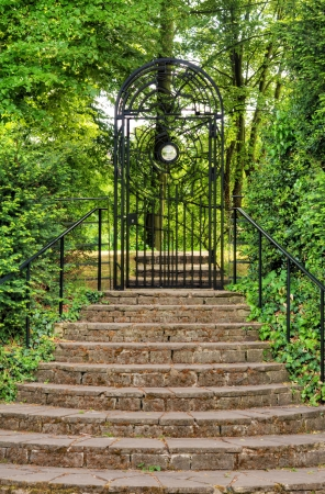 Iron gate in park Stock Photo