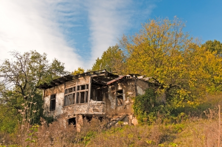 Derelict house in countryside photo