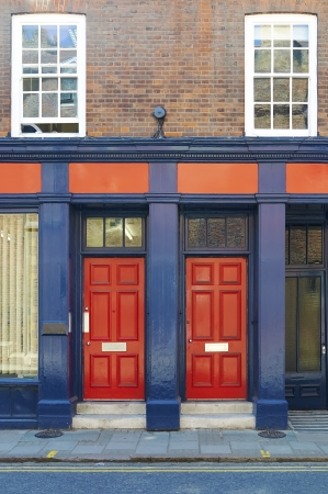 Red doors on building Stock Photo