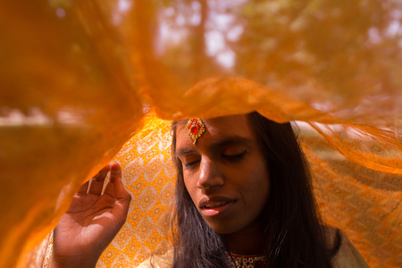 close-up portrait of a young beautiful traditional woman underneath her veil Stock Photo