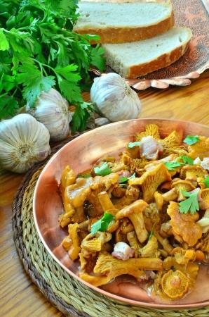 provencal: Chanterelles stewed Provencal style Stock Photo