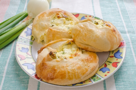 jewish cuisine: Knishes with farmer cheese and scallions - Jewish pastry Stock Photo