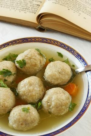 jewish cuisine: Matzo  Matzah  balls soup                  Stock Photo