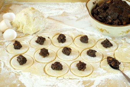 ashkenazi: Preparing cookies with poppy seed filling for Purim (Hamantaschen)