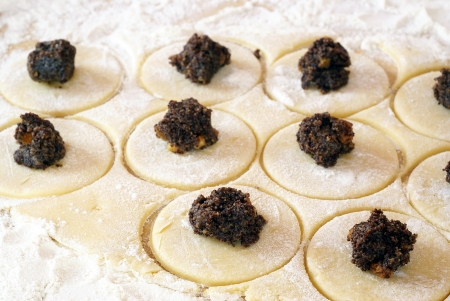 jewish cuisine: Preparing cookies with poppy seed filling for Purim (Hamantaschen)            Stock Photo