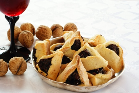 purim: Homemade cookies with poppy seed filling for Purim (Hamantaschen)           Stock Photo