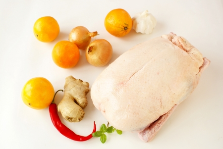 Raw duck with ingredients for French orange sauce                     photo