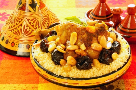 moroccan cuisine: Moroccan chicken with plums and almonds                Stock Photo