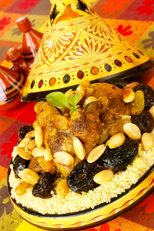 couscous: Moroccan chicken with plums and almonds                Stock Photo
