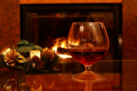 cognac: Christmas brandy by fireplace                      Stock Photo