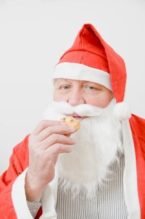 Kerstman eet koekjes Stockfoto